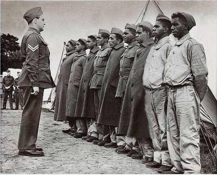 Aboriginal recruits from Lake Tyers lined up for morning parade at Caulfield after joining the 2nd AIF, c. 1940, State Library of Victoria H99.201/282.