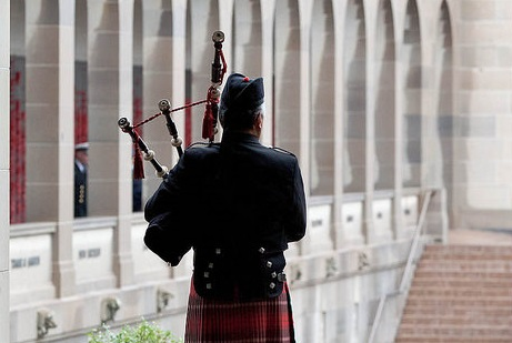A piper at the Memorial's Last Post Ceremony