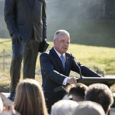 Dr Brendan Nelson speaking in front of Sir John Monash sculpture