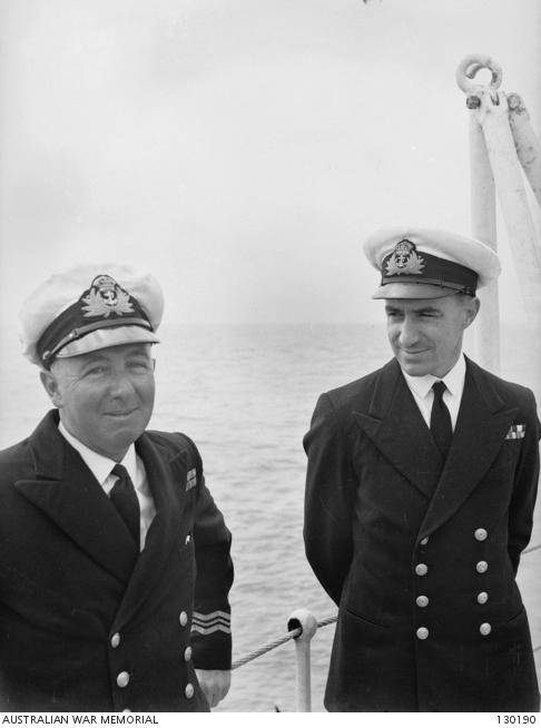 Gunnery Officer Lieutenant Commander R. I. Peek (right), who was severely burned during the kamikaze attack, with Lieutenant Commander C. R. Cliff