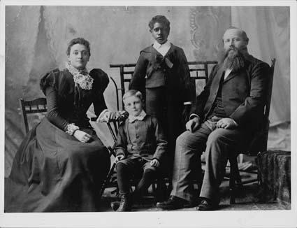 Portrait of Douglas Grant with his adoptive family