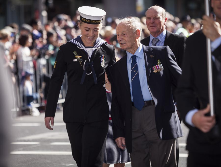 Able Seaman Boatswains Mate Erica Fish marches down Elizabeth Street with her grandfather Cecil Fish