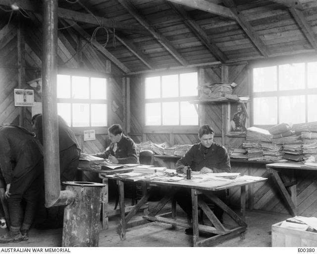 Lieutenant John Treloar (right) working at the Central Registry Office of the 1st Anzac Corps Headquarters, Henencourt, France, 1917. AWM E00380