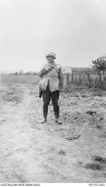 Warrant Officer Harry Hoyling (of Chinese descent) wearing a sheepskin jacket and a gas respirator, France, 1916. AWM P01315.002