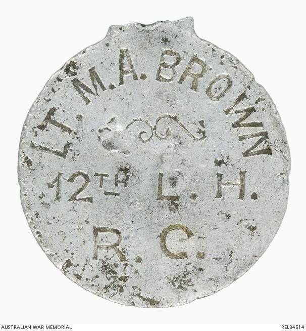 disc marked with LT M A BROWN 12th L H R C
