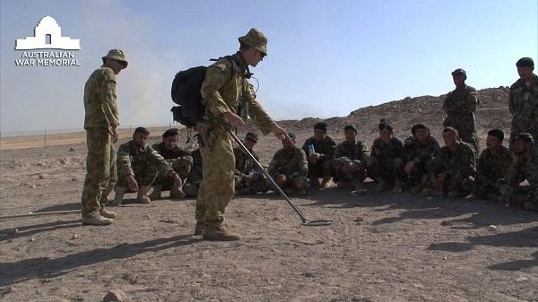 Australian Engineers of the Mentoring Task Force train Afghan National Army members in  the use of metal detectors to find IEDs