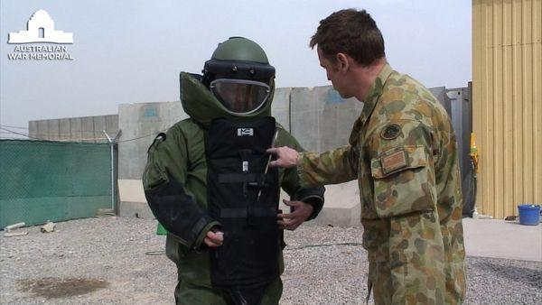 Captain Andy Cullen the Australian Ordnance Explosive Device (OED) troop commander instructing AWM official artist Ben Quilty