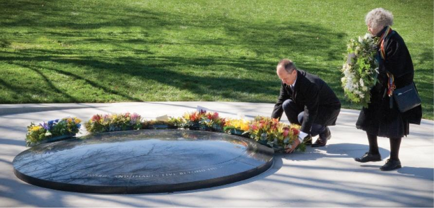 laying wreaths at the dedication of the War correspondents memorial