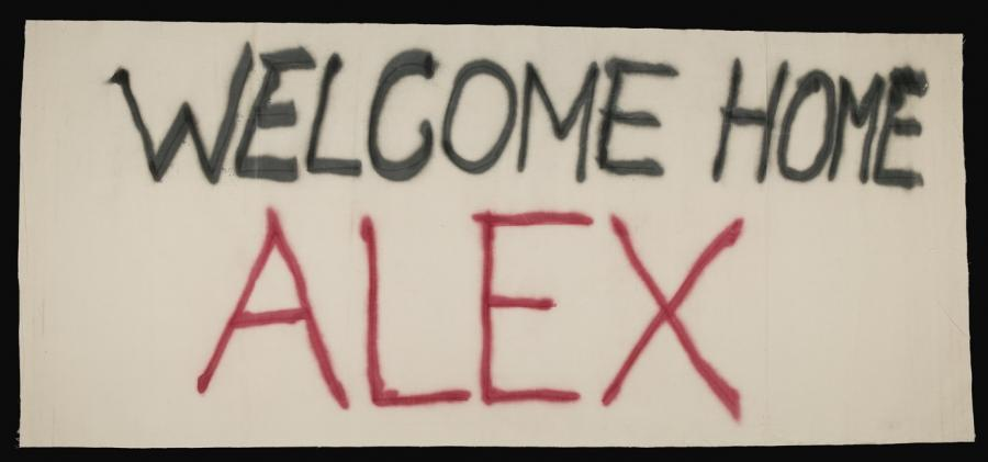 Welcome home banner for Corporal Ali 'Alex' Khalil