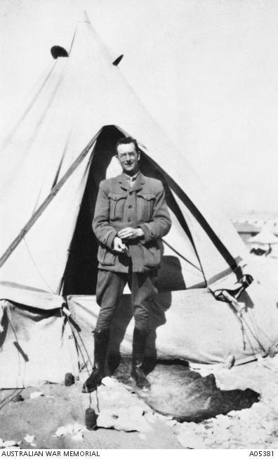 Charles Bean outside his tent in the AIF camp at Mena, Egypt, 1915.